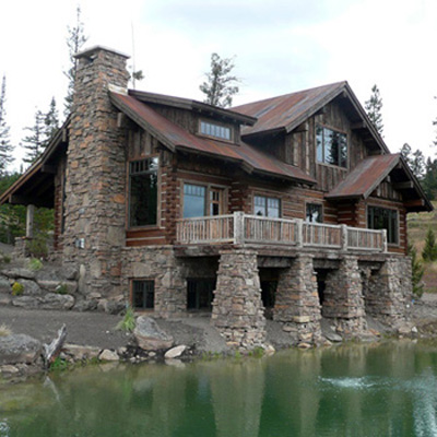 Big Sky Custom Log Home With Incredible Rock Work and Pond