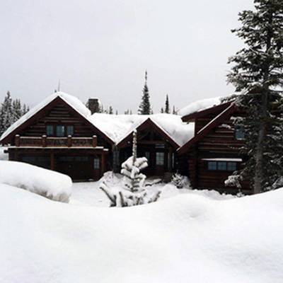 Big Sky MT Custom Log Home In Winter