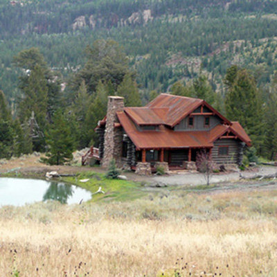Log Home From Distance, Big Sky MT