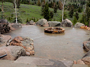 Cement Patio with Custom Rock Fire Pit